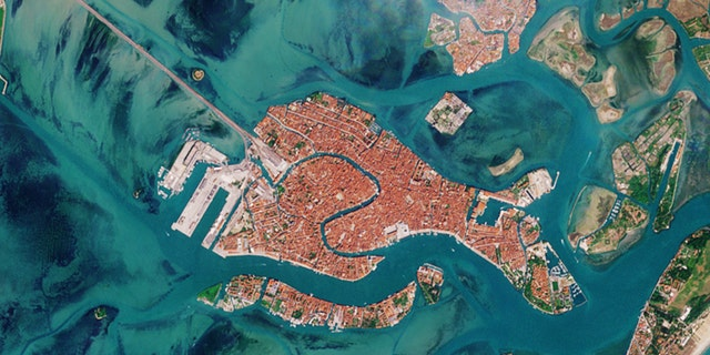 The satellite image of Venice captured April 13, 2020, by the European Space Agency's Copernicus Sentinels satellite fleet, which is dedicated to delivering data and imagery to the European Union's Copernicus environmental program.
