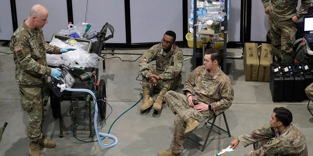 Soldiers took part in a ventilator training session at the site of a military field hospital on Sunday at the CenturyLink Field Event Center in Seattle. (AP Photo/Ted S. Warren)
