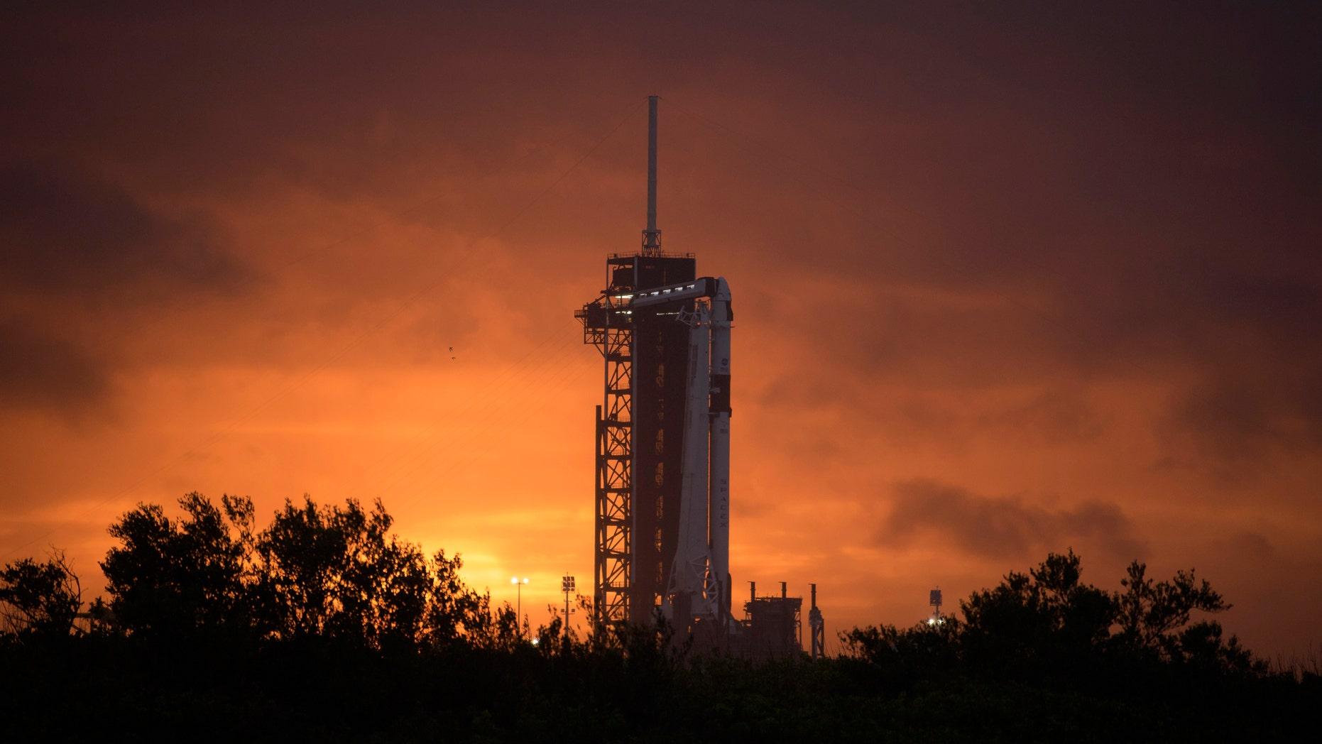 https://a57.foxnews.com/static.foxnews.com/foxnews.com/content/uploads/2020/05/1862/1048/NASASpaceXDemo2.jpg
