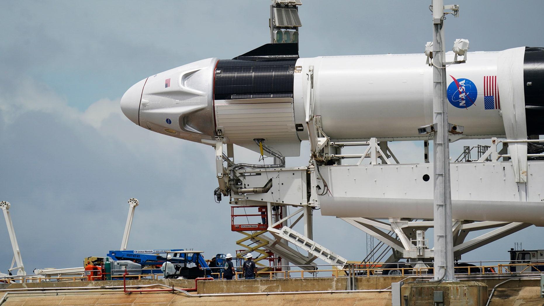 https://a57.foxnews.com/static.foxnews.com/foxnews.com/content/uploads/2020/05/1862/1048/SpaceXNASALaunch3.jpg