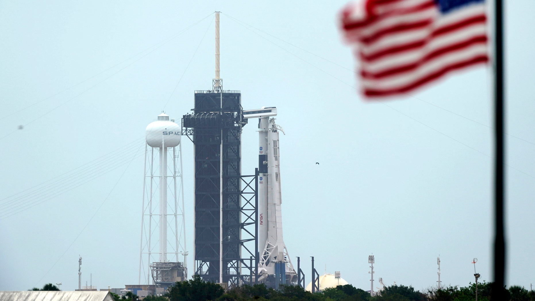 https://a57.foxnews.com/static.foxnews.com/foxnews.com/content/uploads/2020/05/1862/1048/SpaceXNASALaunch4.jpg