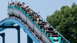 Japanese theme parks will urge guests not to make loud noises on roller coasters upon reopening