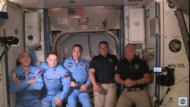 NASA astronauts board International Space Station in historic SpaceX mission