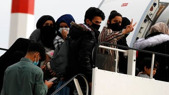 Rescue flight from Greece reunites refugees with close family in UK after coronavirus delayed trip