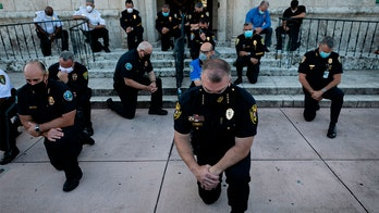 Miami-area police, protesters pray together amid George Floyd unrest