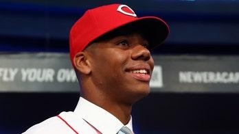 Reds' pitching prospect Hunter Greene fires baseball through car window