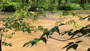 Drunk man rescued after passing out with rum bottle in lap, floating 7 miles down flooded river
