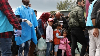 Greece ships hundreds of migrants to mainland amid coronavirus overcrowding fears in Lesbos camp