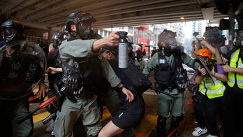 Hong Kong police fire tear gas, water cannon as pro-democracy supporters protest new China law