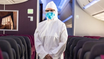 Qatar Airways cabin crew to wear full PPE suits during flights