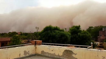 Giant sandstorm looms over city in India, dramatic photos reveal
