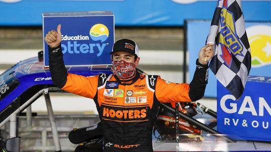 Chase Elliott beats Kyle Busch to win $100,000 bounty in NASCAR Truck Series race