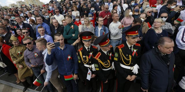 People attend the Victory Day military parade that marked the 75th anniversary of the allied victory over Nazi Germany, in Minsk, Belarus, Saturday, May 9, 2020. Belarus remains one of the few countries that hadn't imposed a lockdown or restricted public events despite recommendations of the World Health Organization.