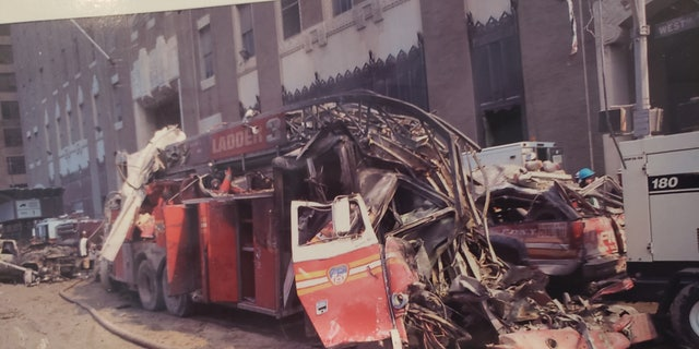 digital products The wreckage on 9/11 of New York City Fire Department Ladder Company 3. Ed Donnelly's brother, Lieutenant Kevin Donnelly, died with Ladder 3 on 9/11.