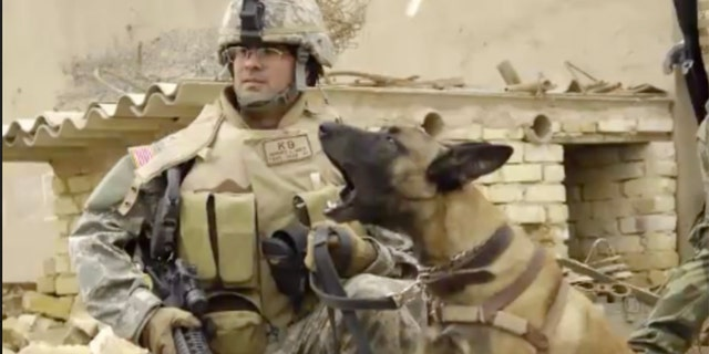 U.S. Air Force Tech. Sgt. Harvey Holt and his military working dog Jackson