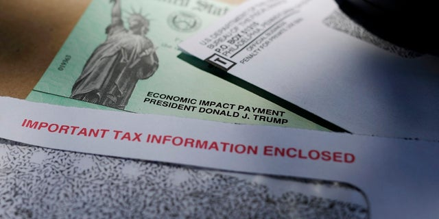 In this April 23, 2020, photo, President Donald Trump's name is seen on a stimulus check issued by the IRS to help combat the adverse economic effects of the COVID-19 outbreak, in San Antonio. (AP Photo/Eric Gay)