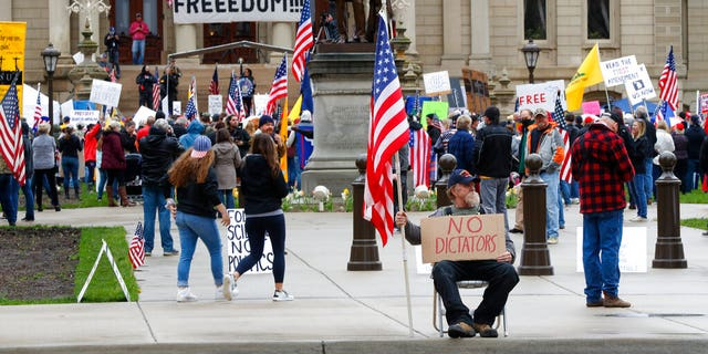 Protesters rally at the State Capitol in Lansing, Mich.