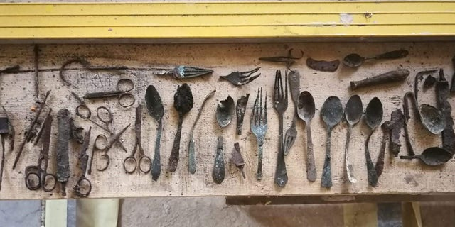 Items hidden by prisoners found in Block 17 of the former Auschwitz main camp, April 21, 2020.