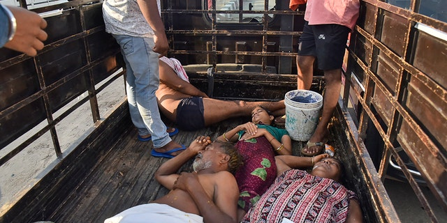 People affected by a chemical gas leak are carried in a truck for medical treatment in Vishakhapatnam, India, Thursday, May 7, 2020. Chemical gas leaked from an industrial plant in southern India early Thursday, leaving people struggling to breathe and collapsing in the streets as they tried to flee. Administrator Vinay Chand said several people fainted on the road and were rushed to a hospital. (AP Photo)