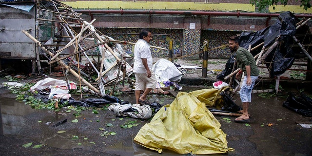 Roadside vendors along a metro station salvage material from his stall after Cyclone Amphan hit the region in Kolkata, India, May 21. (AP Photo/Bikas Das)
