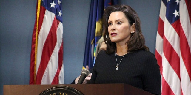 Michigan Gov. Gretchen Whitmer addresses the state during a speech in Lansing, Mich. Some Republican state lawmakers have filed a legal challenge to compel her to reopen the state's economy amid the coronavirus pandemic.