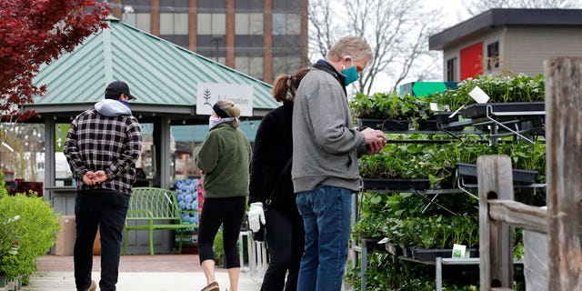 People shop at Lurvey Garden Center & Landscape Suppy store in Des Plaines, Ill., Thursday, April 30, 2020. Illinois garden centers and nurseries will reopen Friday, May 1, 2020 by Governor J.B. Pritzker. Lurvey Home and Garden opened its nursery yard and store on Monday, April 27, 2020.