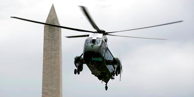 Marine One, with President Donald Trump aboard, approaches the South Lawn of the White House, Sunday, May 3, 2020, in Washington. Trump is returning from a trip to Camp David, Md. (AP Photo/Patrick Semansky)