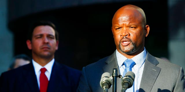 FILE: Acting Broward County sheriff Gregory Tony, right, speaks after being introduced by Florida Gov.