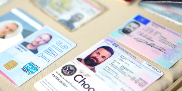 This photo released by the Venezuelan Miraflores presidential press office shows what Venezuelan authorities identify as the the I.D. cards of former U.S. special forces citizen Airan Berry, right, and Luke Denman, left, in Caracas, Venezuela, Monday, May 4, 2020.