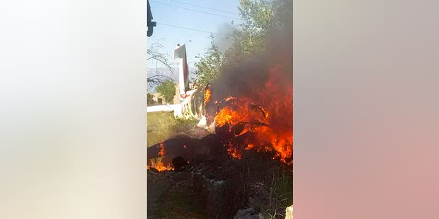 A Croatian air force plane burns after crashing in Biljane, Croatia, Thursday, May 7, 2020. Croatia's Defense Ministry says an air force training plane crashed and two crew members were killed during a routine training flight Thursday afternoon. (Diadora TV via AP)