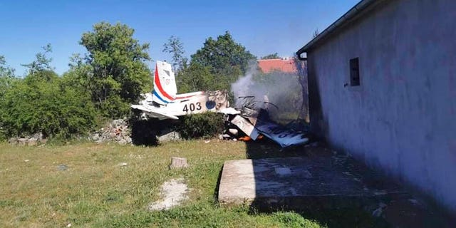 A Croatian air force plane burns after crashing in Biljane, Croatia, Thursday, May 7, 2020. (Diadora TV via AP)