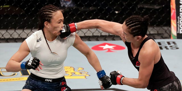 Carla Esparza, right, lands a punch on Michelle Waterson during a UFC 249 mixed martial arts bout, Saturday, May 9, 2020, in Jacksonville, Fla. (Associated Press)