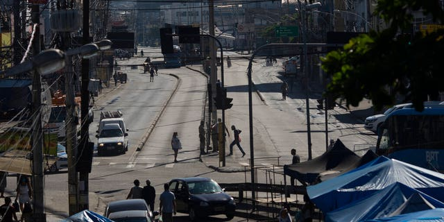 An avenue is partially empty amid increased restrictions on movements in an effort to curb the spread of the new coronavirus in the Madureira neighborhood of Rio de Janeiro, Brazil.