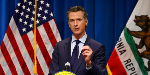 California Gov. Gavin Newsom discusses his revised 2020-2021 state budget during a news conference in Sacramento, Calif., Thursday, May 14, 2020.