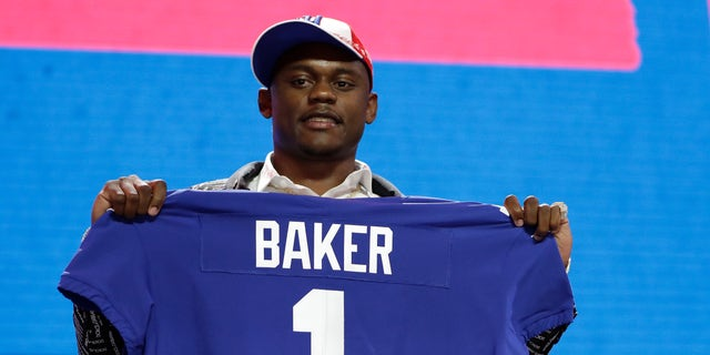 Georgia defensive back DeAndre Baker poses with his new jersey after the New York Giants selected him in the first round at the NFL football draft in Nashville, Tenn last April. Miramar police issued arrest warrants for both men last Thursday. (AP Photo/Mark Humphrey, File)