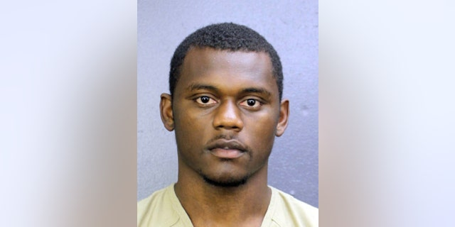 This booking photo provided by the Broward County, Fla., Sheriff's Office shows DeAndre Baker. Baker is charged with four counts of armed robbery with a firearm and four counts of aggravated assault with a firearm. He turned himself in at the Broward County Jail. (Broward County Sheriff's Office via AP)