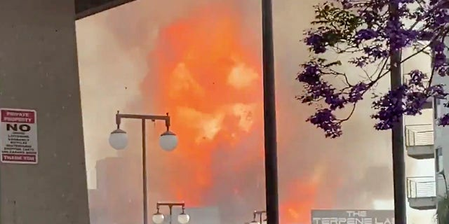 In this screen grab from video provided by Sean Miura, flames from an explosion are seen Saturday, May 16, 2020, in Los Angeles. (Associated Press)