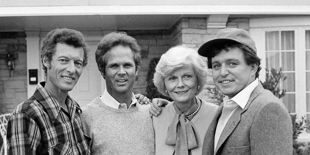 This Dec. 10, 1982, file photo shows members of the original cast of the 'Leave It to Beaver.' From left, Ken Osmond, Tony Dow, Barbara Billingsley and Jerry Mathers during the filming of their TV special, 'Still The Beaver,' in Los Angeles. Osmond, who played the two-faced teenage scoundrel Eddie Haskell on TV's 'Leave it to Beaver,' has died. Osmond's family says he died Monday, May 18, 2020, in Los Angeles. He was 76.