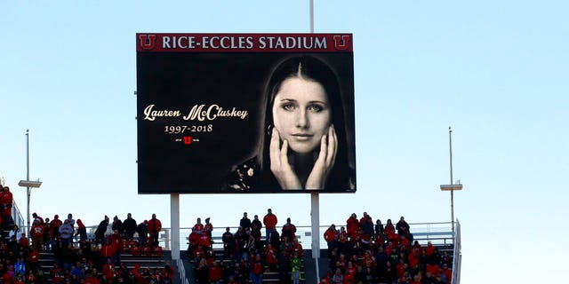 FILE: A photograph of University of Utah student and track athlete Lauren McCluskey, who was fatally shot on campus, is projected on the video board before the start of an NCAA college football game between Oregon and Utah in Salt Lake City.