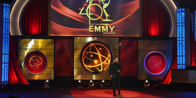 FILE - This May 5, 2019 file photo shows host Mario Lopez on stage at the 46th annual Daytime Emmy Awards in Pasadena, Calif.