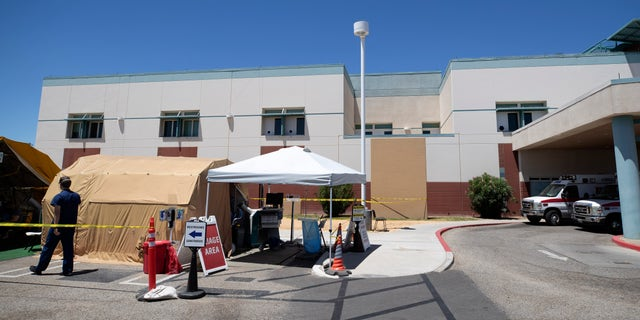A tent in front of the El Centro Regional Medical Center in California, where staffers help process patients with symptoms related to the coronavirus.