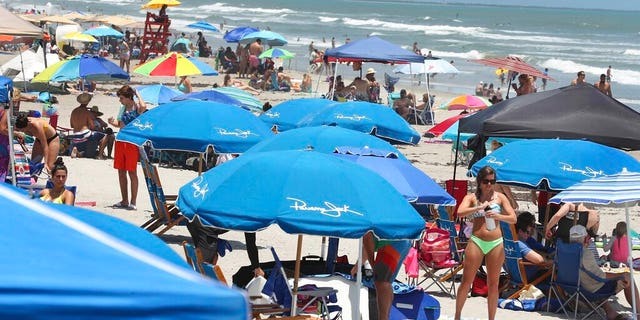 Cocoa Beach, Fla., packed with Memorial Day beachgoers on Saturday. (Stephen M. Dowell/Orlando Sentinel via AP)