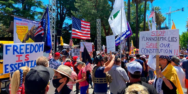 "Protesters gathered outside the ""Liberty Fest"" rally in front of California State Capitol, Saturday, May 23, 2020, in Sacramento, Calif., to protest Gov. Gavin Newsom's Stay At Home Order to stem the coronavirus outbreak."