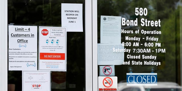 Information signs are displayed at an Illinois Air Team Test Station in Lincolnshire, Ill., Wednesday, May 27, 2020.聽