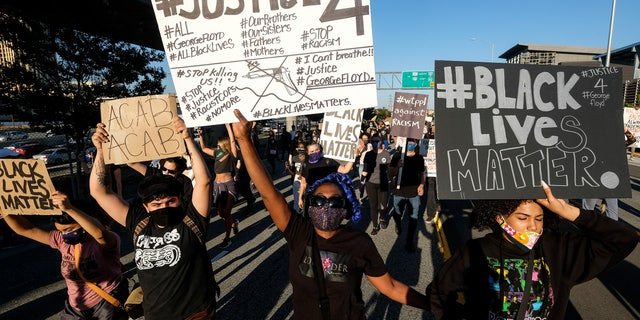 Demonstrators shut down the Hollywood Freeway in Los Angeles on Wednesday, May 27, 2020, during a protest about the death of George Floyd in police custody in Minneapolis earlier in the week. (Associated Press)