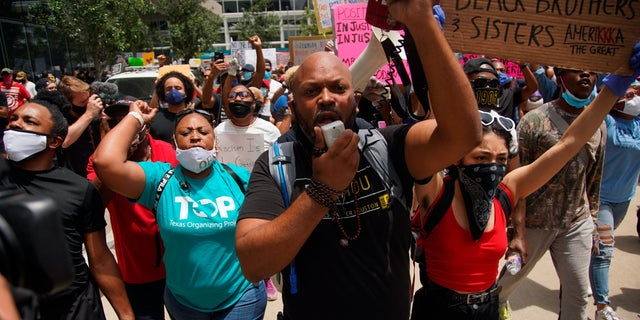 Black Lives Matter protesters rally in honor of George Floyd at Discovery Green in Houston, Friday, May 29, 2020. Floyd died Memorial Day while in the custody of the Minneapolis police. (Elizabeth Conley/Houston Chronicle via AP)