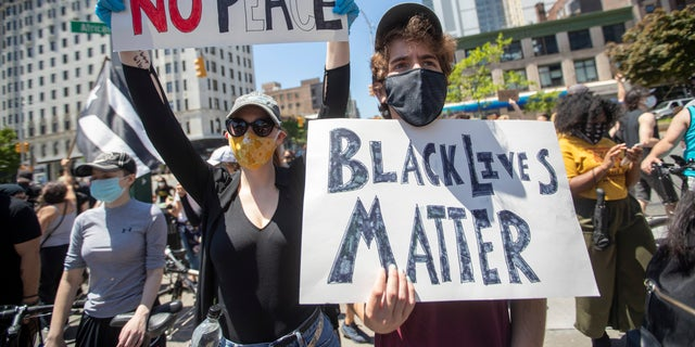 Demonstrators participate in a solidarity rally for George Floyd, Saturday, May 30, 2020, in the Harlem neighborhood of New York. Floyd died after Minneapolis police officer Derek Chauvin pressed his knee into his neck for several minutes even after he stopped moving and pleading for air. (AP Photo/Mary Altaffer)