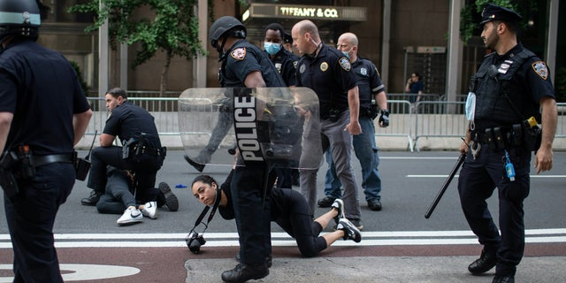 Police detain protesters in front of Trump Tower during a solidarity rally for George Floyd, Saturday, May 30, 2020, in New York. Demonstrators took to the streets of New York City to protest the death of Floyd, a black man who was killed in police custody in Minneapolis on May 25. (AP Photo/Wong Maye-E)
