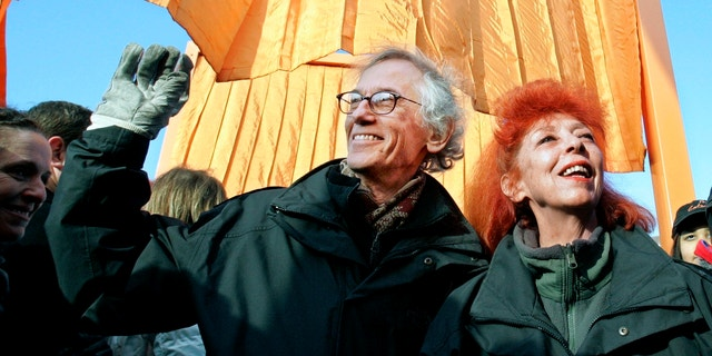 """Artists Christo, left, and his wife and partner Jeanne-Claude, participating in the opening of """"The Gates"""" in New York's Central Park in 2005."""