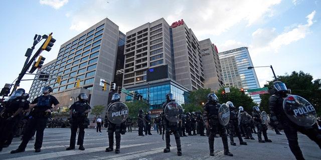 Atlanta Police, monitor demonstrators protesting, Saturday, May 30, 2020 in Atlanta.